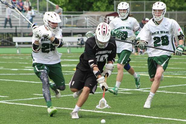 Farmington's Connor Hillemeir, front, tries to scoop the ball as New Milford's Michael Getman, left, Nate Capriglione, second from right, and Kyle Wilton, right, defend during the boys lacrosse Class L state tournament qualifying-round game at New Milford High School May 27, 2017.