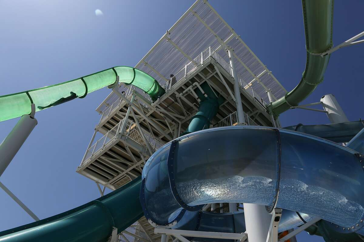 A man goes down the Emerald Plunge slide at The Wave water park on Saturday, May 26, 2017 in Dublin, Calif.