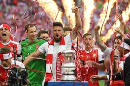 LONDON, ENGLAND - MAY 27:  Olivier Giroud of Arsenal celebrates with the trophy after The Emirates FA Cup Final between Arsenal and Chelsea at Wembley Stadium on May 27, 2017 in London, England.  (Photo by Laurence Griffiths/Getty Images)