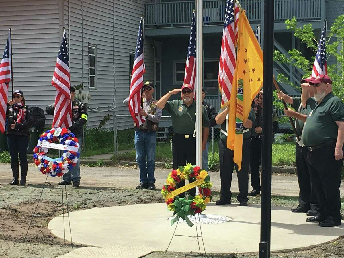 Veterans on Saturday, May 27 honor the memory of Peter M. Guenette, who was killed in Vietnam in 1968. Troy Housing Authority apartments on 115th Street and Second Avenue in the Lansingburgh section of Troy will bear his name. (Chris Bragg / Times Union)