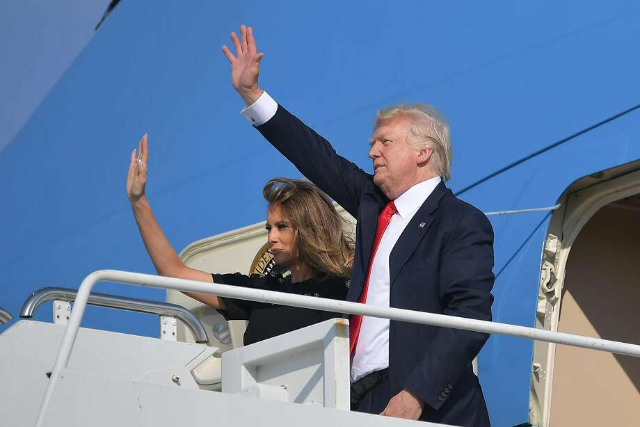 US President Donald Trump and US First Lady Melania Trump wave as they board Air Force One before departing from US military Naval Air Station Sigonella following a G7 summit of Heads of State and Government, on May 27, 2017 near Taormina in Sicily. Photo: MANDEL NGAN, AFP/Getty Images