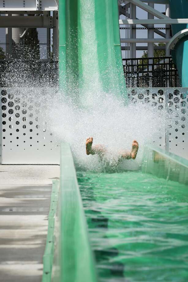 Isabella Trinchese, 9, splashes down the Emerald Plunge on Saturday before the slide was shut down. Photo: Amy Osborne, Special To The Chronicle