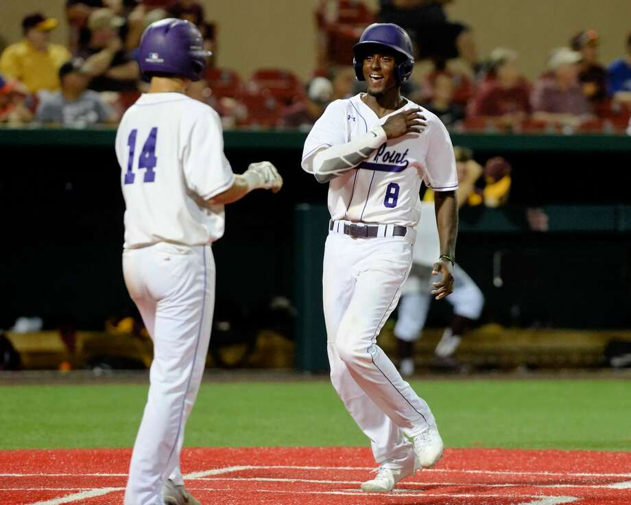 Aaron Allen (8) of Ridge Point scores on an RBI double by Zach Johnson (12) in the fifth inning during game 2 of a 6A Region III semifinal baseball playoff series between the Ridge Point Panthers and the Deer Park Deer on Friday May 26, 2017 at Schroeder Park, Houston, TX. Photo: Craig Moseley/Houston Chronicle
