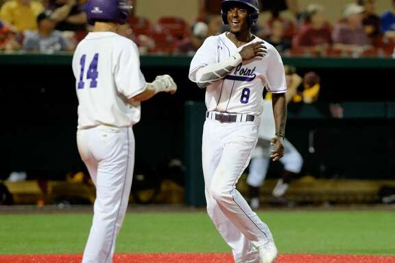 Aaron Allen (8) of Ridge Point scores on an RBI double by Zach Johnson (12) in the fifth inning during game 2 of a 6A Region III semifinal baseball playoff series between the Ridge Point Panthers and the Deer Park Deer on Friday May 26, 2017 at Schroeder Park, Houston, TX.