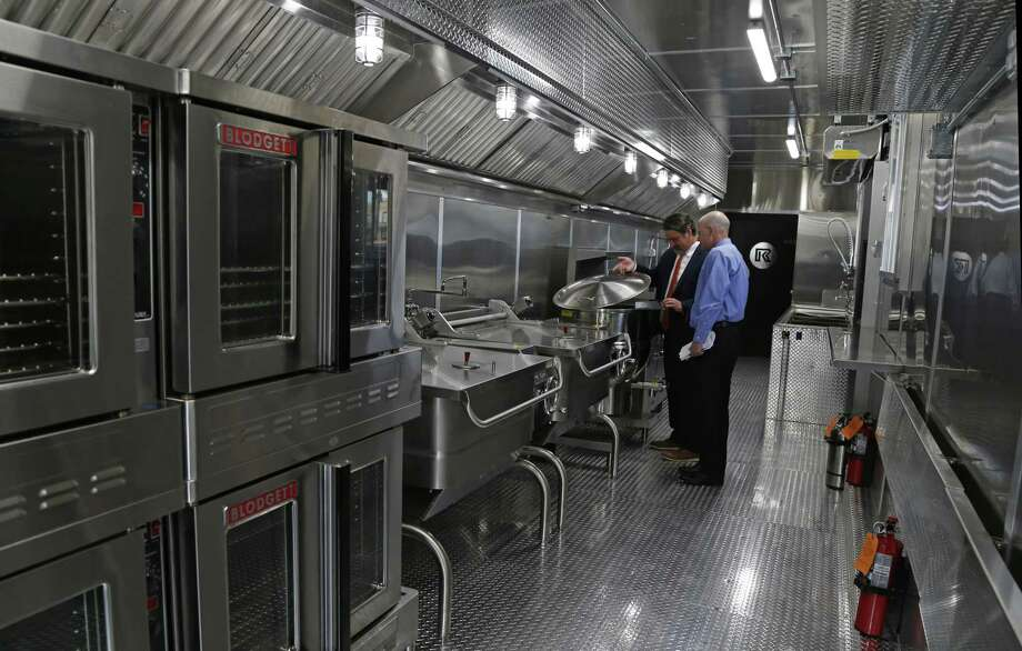 A 57-foot mobile kitchen from RK Emergency Management Support can generate 10,000 meals in three hours, company officials say. Photo: Ron Cortes /For The San Antonio Express-News / Freelance