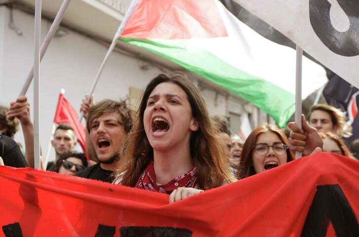 Demonstrators shout slogans during an anti-G7 rally near the venue of the G7 summit in the Sicilian town of Taormina, Italy, on Saturday.