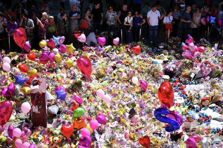 """A carpet of messages of support and floral tributes to the victims of the Manchester attack lies in St Ann's Square in Manchester on May 27, 2017. British police said they arrested two more people during raids Saturday in connection with the suicide bombing at a Manchester concert, with a """"large part"""" of the network behind the attack now being held. / AFP PHOTO / Ben STANSALLBEN STANSALL/AFP/Getty Images"""