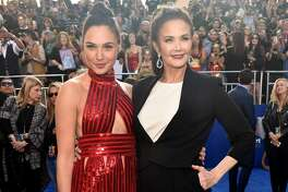 """HOLLYWOOD, CA - MAY 25:  Actors Gal Gadot (L) and Lynda Carter attend the premiere of Warner Bros. Pictures' """"Wonder Woman"""" at the Pantages Theatre on May 25, 2017 in Hollywood, California.  (Photo by Alberto E. Rodriguez/Getty Images)"""