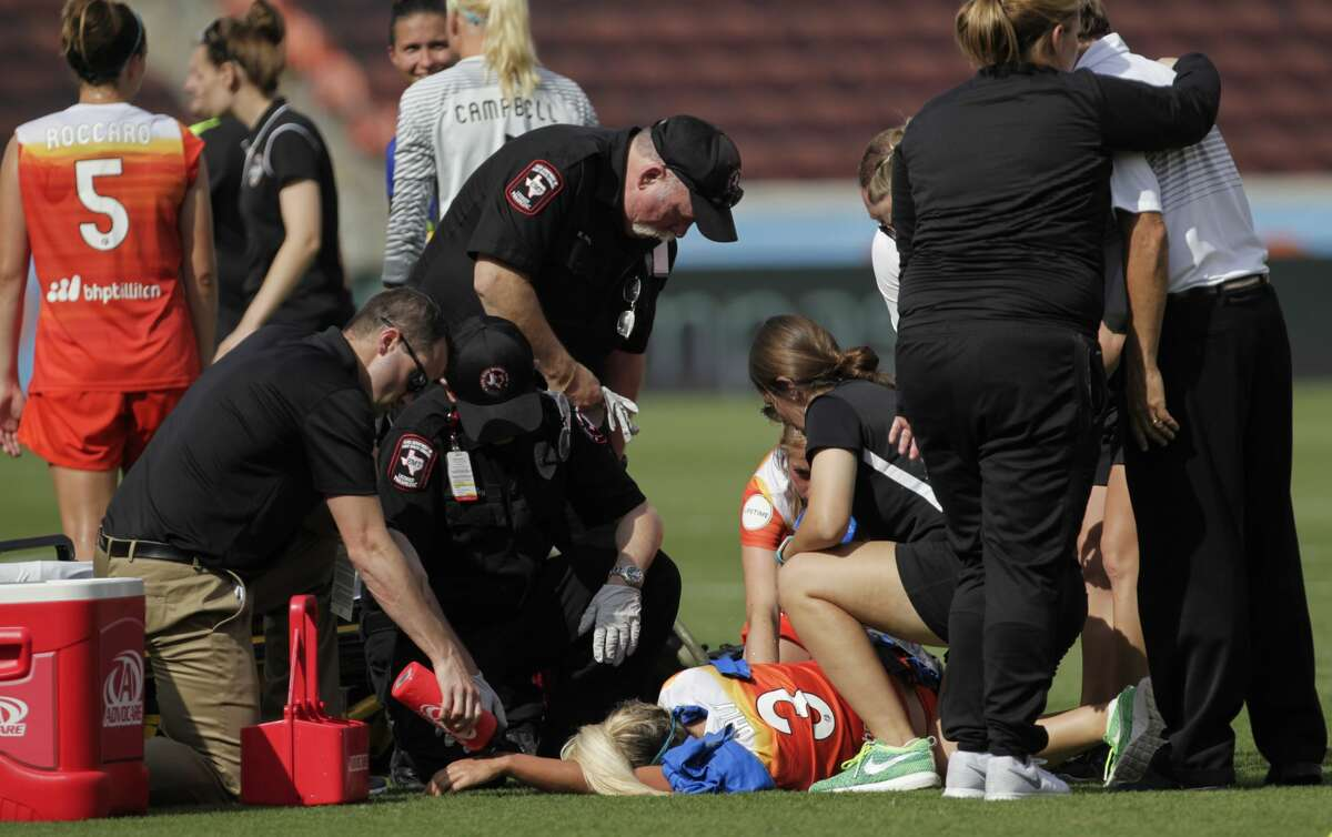 Paramedics gather to check on Houston Dash forward Rachel Daly (3), who went down after taking three shots at the goal and seconds before the end of the game, while Seattle Reign FC head coach Laura Harvey talking to Houston Dash head coach Randy Waldrum at BBVA Compas Stadium Saturday, May 27, 2017, in Houston. Dash lost to Reign 2-0. ( Yi-Chin Lee / Houston Chronicle )