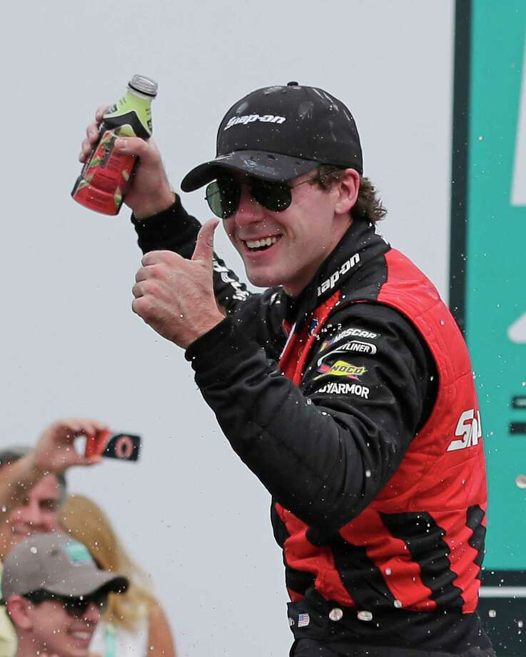 Ryan Blaney celebrates in Victory Lane after winning the NASCAR Xfinity series auto race at Charlotte Motor Speedway in Concord, N.C., Saturday, May 27, 2017. (AP Photo/Chuck Burton) Photo: Chuck Burton, STF / Copyright 2017 The Associated Press. All rights reserved.