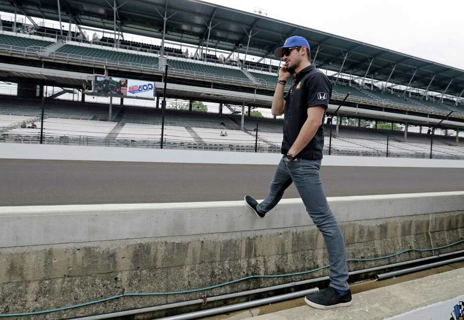 Alexander Rossi talks on the phone as he waits for the start of the drivers meeting for the Indianapolis 500 auto race at Indianapolis Motor Speedway, Saturday, May 27, 2017, in Indianapolis. The 101st running of the race is Sunday. (AP Photo/Darron Cummings) Photo: Darron Cummings, STF / Copyright 2017 The Associated Press. All rights reserved.