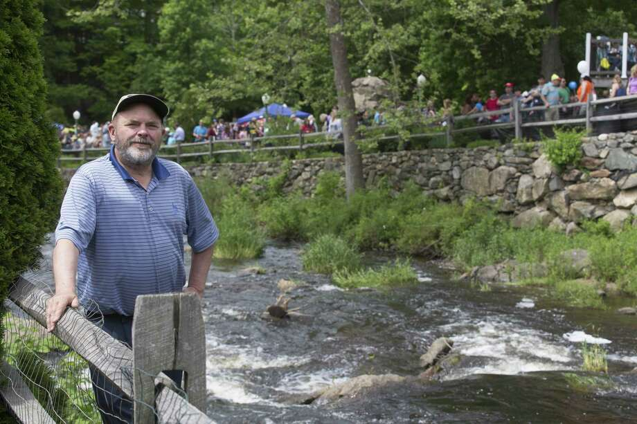 Probate Judge Daniel O'Grady, of Newtown, was a volunteer duck guider at the 2017 Great Pootatuck Duck Race in Newtown, Conn. on Saturday, May 27. Photo: Christopher Burns / For Hearst Connecticut Media / The News-Times Freelance