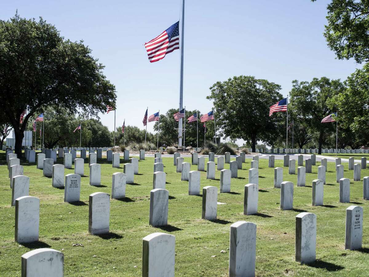 The flag flies at half-staff in the Fort Sam Houston National Cemetery after the funeral for centenarian Air Force Lt. Col. Glenn W. Taylor, who fought in WWII, Korea and Vietnam.