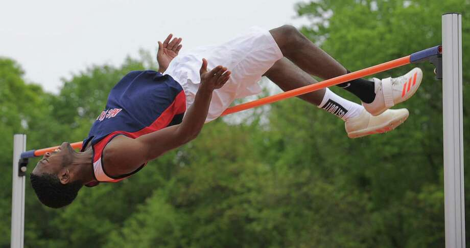 McMahon's Justin Forde clears 6-06.00 to take second place in the boys high jump during the FCIAC boys track and field championship Tuesday. Photo: Matthew Brown / Hearst Connecticut Media / Stamford Advocate
