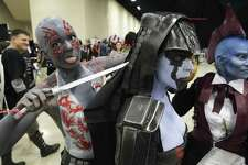 Guardians of the Galaxy character Drax the Destroyer (Stephanie Willmott) feigns an attack on Emm Pole who was posing for photos with Cindy Salvus (right) at the Alamo City Comic Con at the Henry B. Gonzalez Convention Center on May 27, 2017.