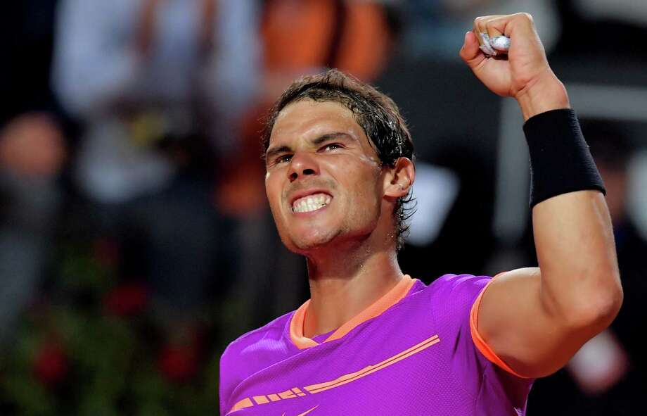 Despite losing in the Italian Open quarterfinals, Rafael Nadal is on a roll entering the French Open, having won titles on clay at Monte Carlo, Barcelona and Madrid. Photo: TIZIANA FABI, Staff / AFP or licensors