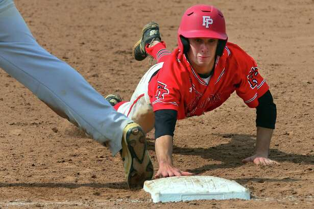 Prep's Matthew Zaffino dives back to first to avoid a pick off during Saturday's SCC championship against Amity in West Haven.