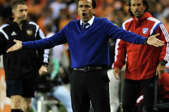 FC Dallas head coach Oscar Pareja argues a call during the first half of an MLS soccer game against Houston, Saturday, April 5, 2014, at BBVA Compass Stadium in Houston.