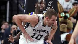 San Antonio Spurs' David Lee injures himself while trying to scoring against Golden State Warriors' Draymond Green in 1st quarter of Warriors' 120-108 win during Game 3 of NBA Western Conference Finals at AT&T Center in San Antonio, Texas, on Saturday, May 20, 2017.