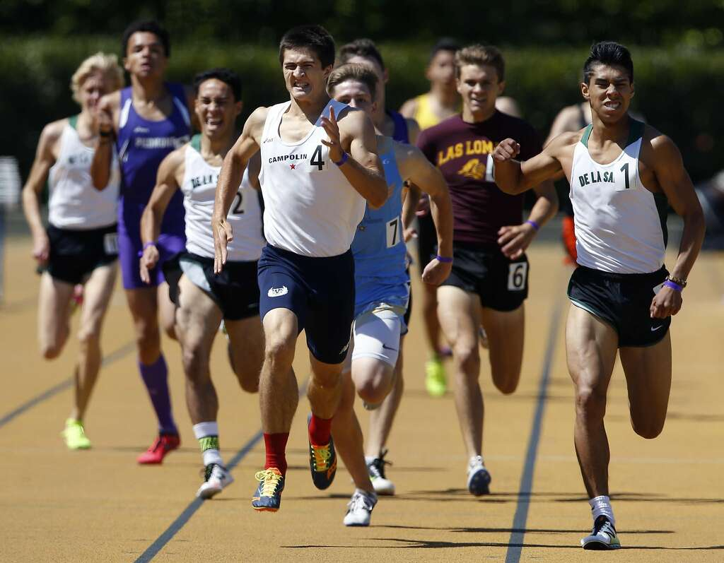Campolindo's Niki Moore (center) edges out De La Salle High's Isaias De Leon (right) and the rest of the field to take first place in the boys 800 meter run at the North Coast Section Meet of Champions in Berkeley, Calif. on Saturday, May 27, 2017. Photo: Paul Chinn, The Chronicle