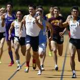 Campolindo's Niki Moore (center) edges out De La Salle High's Isaias De Leon (right) and the rest of the field to take first place in the boys 800 meter run at the North Coast Section Meet of Champions in Berkeley, Calif. on Saturday, May 27, 2017.