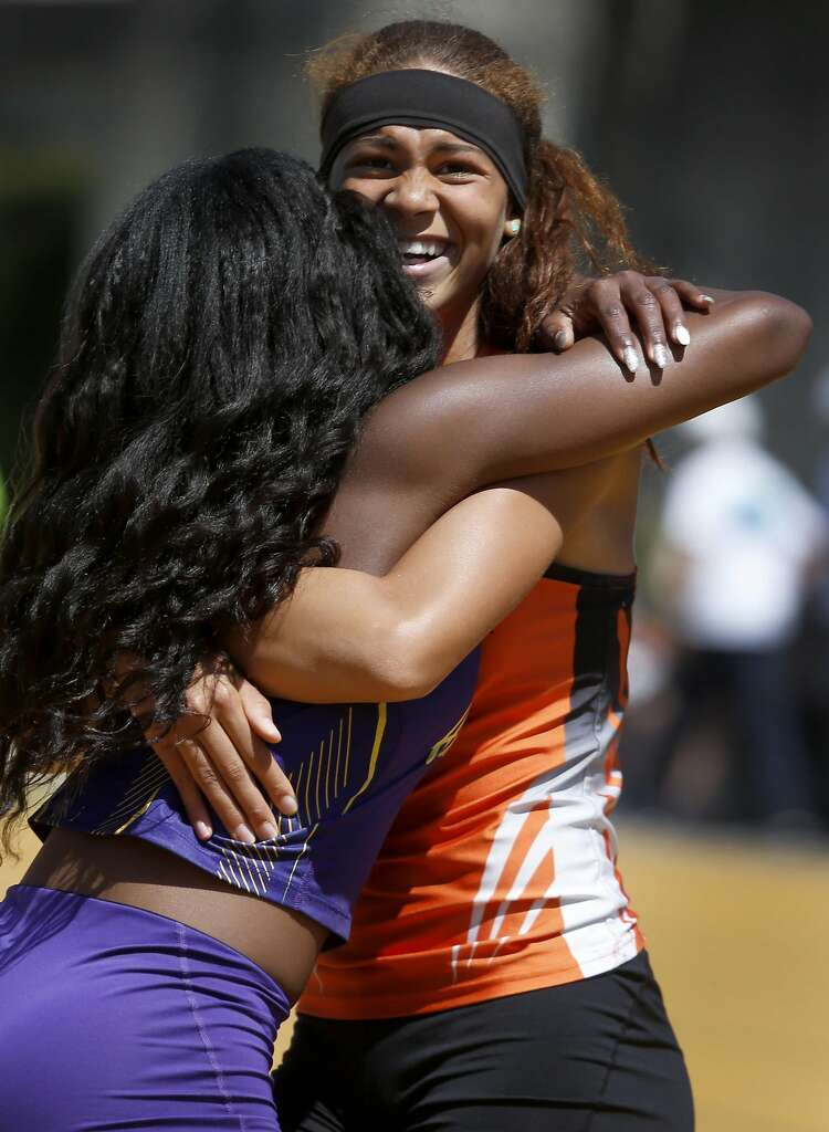 Santa Rosa High School's Kirsten Carter hugs Chinyere Okoro (left) from Amador Valley High after Carter narrowly defeated Okoro and took first place in the girls 100 meter run at the North Coast Section Meet of Champions in Berkeley, Calif. on Saturday, May 27, 2017. Photo: Paul Chinn, The Chronicle