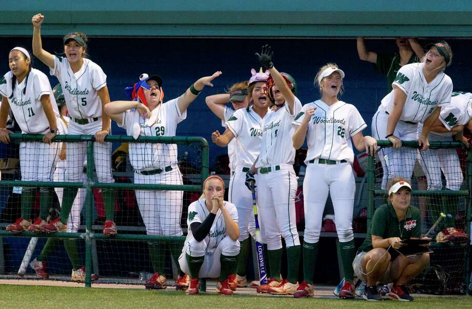 The Woodlands senior and starting pitcher Emily Langkamp, center, watches play as teammates cheer on Abby Jones during the bottom of the seventh inning in Game 2 of a Region II-6A final high school softball series at the Mumford Athletic Complex, Friday, May 26, 2017, in Mumford. Bowie defeated The Woodlands 3-0 to advance to the state tournament. Photo: Jason Fochtman, Staff Photographer / © 2017 Houston Chronicle