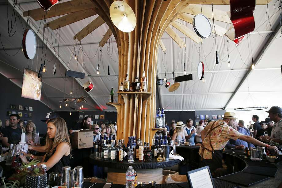 A $3,500 ticket  for the weekend opened access  to the Platinum Lounge, right, plus front-row access to stages, gourmet food and drinks, private parking and meet-and-greets with musical artists. Photo: Santiago Mejia, The Chronicle
