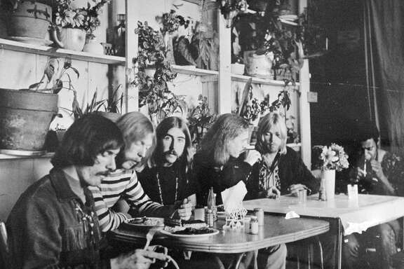 Members of the Allman Brothers Band, from left, Dickey Betts, Duane Allman, Berry Oakley, Butch Trucks, Gregg Allman and Jai Johanny Johanson, dine in Macon, Ga. during the band's formative years.