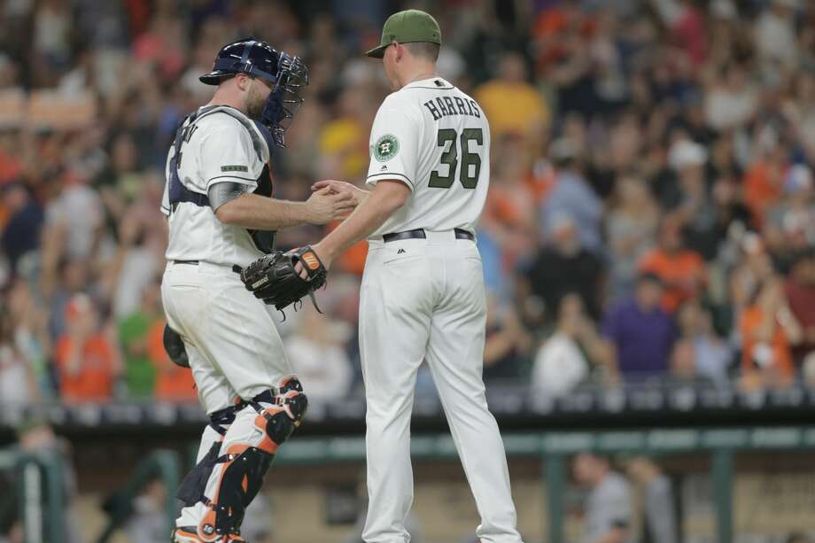 Houston Astros catcher Brian McCann (16) and pitcher Will Harris (36) celebrate the Astros 5-2 win over Baltimore Orioles.  Houston Astros and Baltimore Orioles in the second of a three-game series at Minute Maid Park on Saturday, May 27, 2017, in Houston. Astros lead the series 2-0. ( Elizabeth Conley / Houston Chronicle ) Photo: Elizabeth Conley/Houston Chronicle
