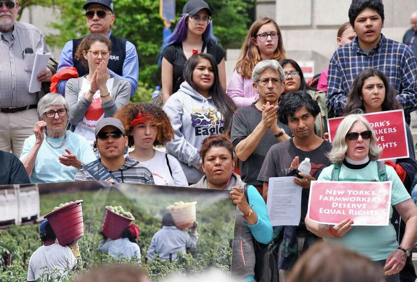 Farmworkers, activists, and allies rally outside the Capitol to advocate for the Farmworker Fair Labor Practices Act Tuesday May 23, 2017 in Albany, NY. (John Carl D'Annibale / Times Union)