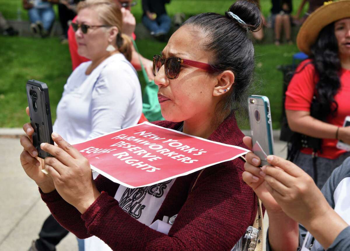 Imelda Garzon, a worker on a duck farm in Liberty, NY, listens to speakers during a rally outside the Capitol to advocate for the Farmworker Fair Labor Practices Act Tuesday May 23, 2017 in Albany, NY. (John Carl D'Annibale / Times Union)
