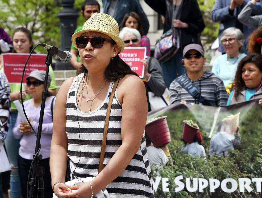 Elena Lopez, a worker on a dairy farm from western NY, speaks during a rally outside the Capitol to advocate for the Farmworker Fair Labor Practices Act Tuesday May 23, 2017 in Albany, NY. (John Carl D'Annibale / Times Union)