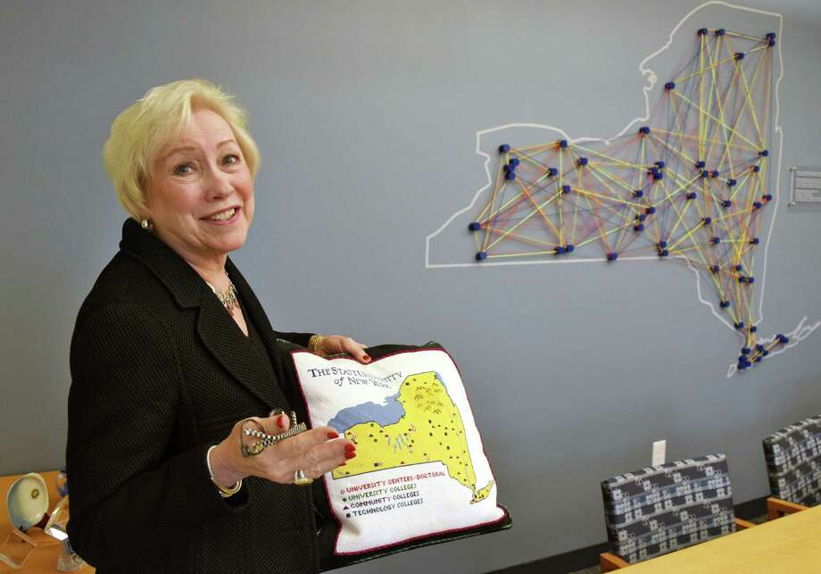 SUNY Chancellor Nancy Zimpher with a needlepoint pillow and a string art map both showing all 64 SUNYcampuses in her office Thursday May 25, 2017 in Albany, NY.  (John Carl D'Annibale / Times Union) Photo: John Carl D'Annibale / 20040563A