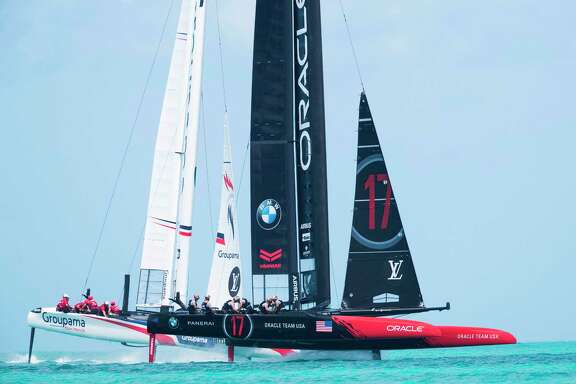 Groupama Team France, left, races Oracle Team USA as the 35th America's Cup gets going Saturday on Bermuda's Great Sound. Team USA won and then beat Emirates Team New Zealand later in the day.