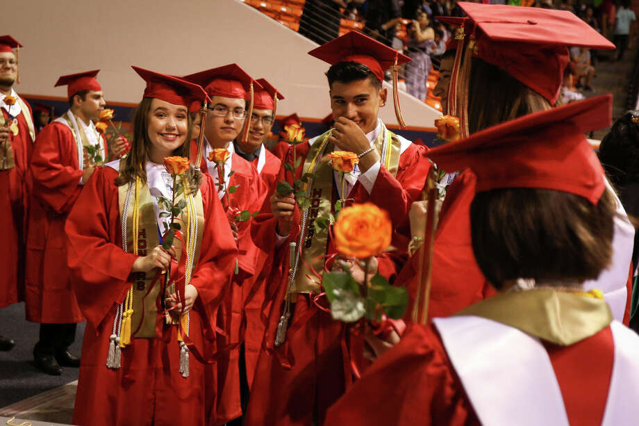 Graduates mingle before the start of the Caney Creek High School commencement ceremony on Saturday, May 27, 2017, at Sam Houston State University. Photo: Michael Minasi, Staff Photographer / © 2017 Houston Chronicle