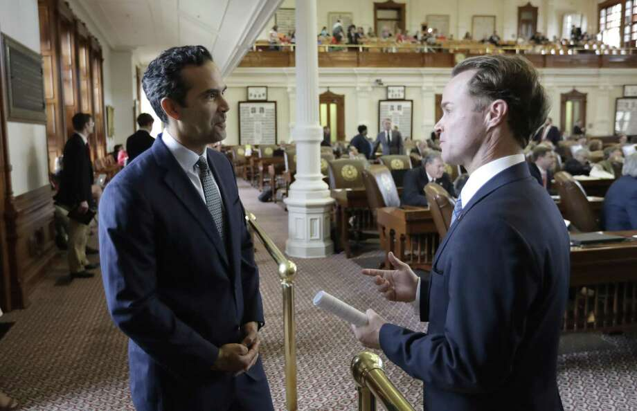 Texas Land Commissioner George P. Bush talks with state Rep. Date Phelan, R-Port Neches, at the Texas House as law makers rush to finish business, Friday, May 26, 2017, in Austin, Texas. The current session of the Texas Legislature ends Monday. (AP Photo/Eric Gay) Photo: Eric Gay, STF / Associated Press / Copyright 2017 The Associated Press. All rights reserved.