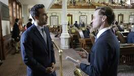 Texas Land Commissioner George P. Bush talks with state Rep. Date Phelan, R-Port Neches, at the Texas House as law makers rush to finish business, Friday, May 26, 2017, in Austin, Texas. The current session of the Texas Legislature ends Monday. (AP Photo/Eric Gay)