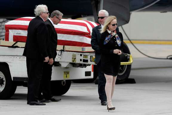 "Deborah Crosby said she was ""just overwhelmed"" to see her father's casket upon its arrival on Friday."