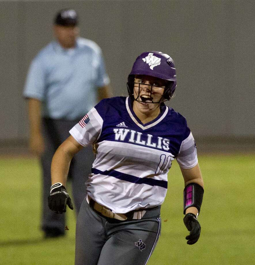 Rachel Brown #11 of Willis celebrates after her walk-off, two-run homer during the ninth inning in Game 3 of a Region III-5A final high school softball series at Cougar Softball Stadium, Saturday, May 27, 2017, in Houston. Wilis defeated Barbers Hill 5-3. Photo: Jason Fochtman/Houston Chronicle