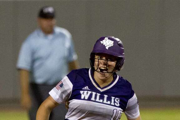 Rachel Brown #11 of Willis celebrates after her walk-off, two-run homer during the ninth inning in Game 3 of a Region III-5A final high school softball series at Cougar Softball Stadium, Saturday, May 27, 2017, in Houston. Wilis defeated Barbers Hill 5-3.