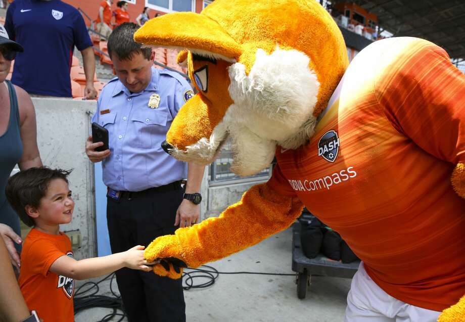 Houston Dash mascot Diesel greets a young fan before the the team takes on Seattle Reign FC at BBVA Compas Stadium Saturday, May 27, 2017, in Houston. ( Yi-Chin Lee / Houston Chronicle ) Photo: Yi-Chin Lee/Houston Chronicle