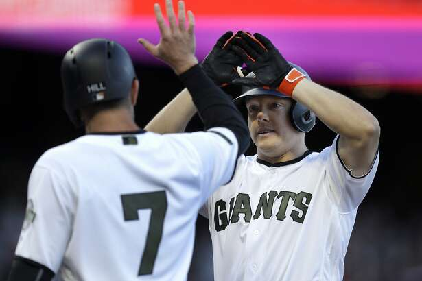 San Francisco Giants' Nick Hundley, right, celebrates with Aaron Hill (7) after hitting a two-run home run off Atlanta Braves' Mike Foltynewicz in the second inning of a baseball game Saturday, May 27, 2017, in San Francisco. (AP Photo/Ben Margot)