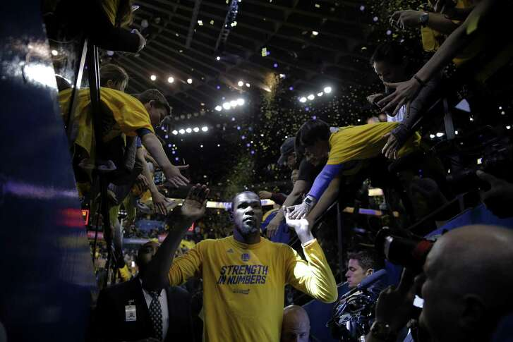 Golden State Warriors forward Kevin Durant (35) following the end of Game 2 of the NBA Western Conference Finals between the Golden State Warriors and San Antonio Spurs on Tuesday, May 16, 2017, at Oracle Arena in Oakland, Calif. The Warriors won 136-100 and lead the series 2-0.