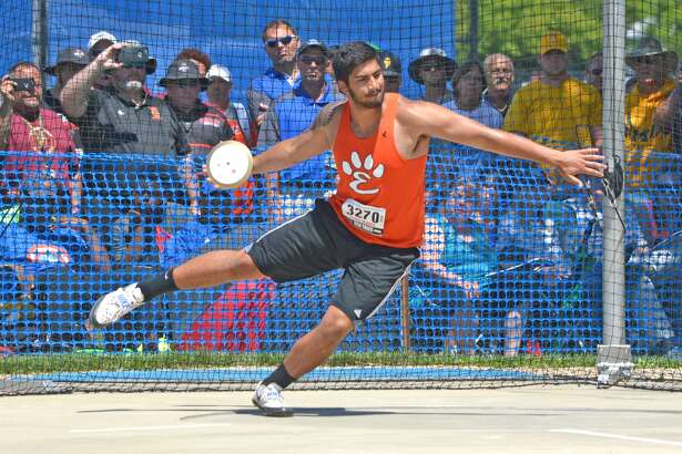 Edwardsville senior AJ Epenesa competes in the discus on Saturday during the finals of the Class 3A state meet at O'Brien Stadium in Charleston.