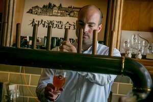 Bar manager Chase Branden Cottrell pours a beer at Hitachino in San Francisco, Calif., is seen on May 27th, 2017.