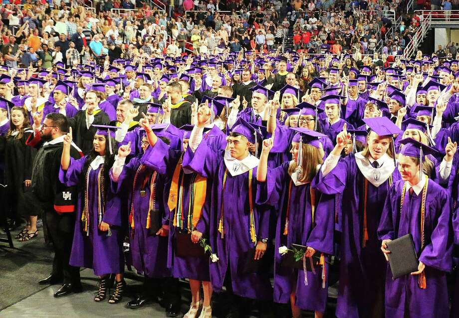 Dayton High School Class of 2017 sings the school song for a final time. The Broncos graduated on Saturday at the Montagne Center on the campus of Lamar University. Photo: David Taylor