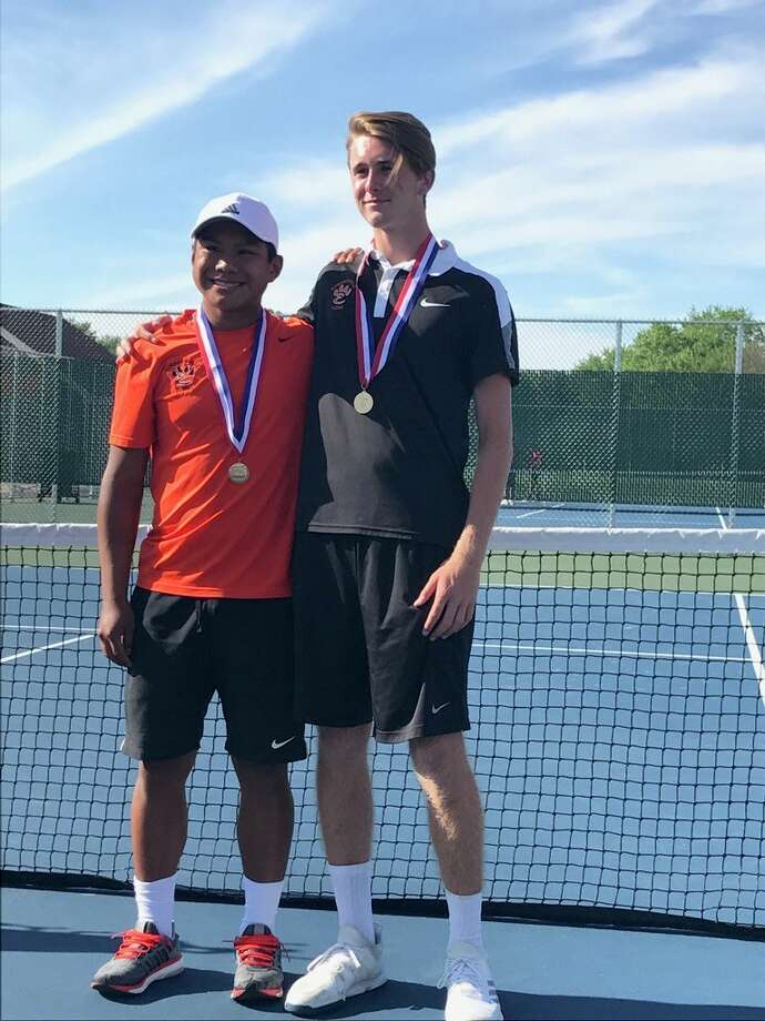 Edwardsville's Zach Trimpe, left, and Alex Gray pose with their medals on Saturday after winning the state championship in doubles.