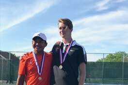 Edwardsville's Zach Trimpe (left) and Alex Gray pose with their medals on Saturday after winning the state championship in doubles.