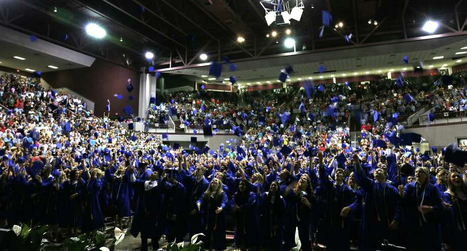 The New Caney High School Class of 2017 celebrates graduation with the traditional cap throw at the M.O. Campbell Educational Center May 27. Photo: Submitted